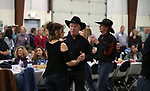 "Line dancers perform for the crowd at the ""We Are Western"" event hosted by the Western Nevada College Foundation, in Carson City, Nev., on Friday, March 8, 2019. <br /> Photo by Cathleen Allison/Nevada Momentum"