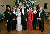 """.President George W. Bush and Mrs. Laura Bush stand with the Kennedy Center honorees in the Blue Room of the White House during a reception Sunday, Dec. 3, 2006. From left, they are: singer and songwriter Willam """"Smokey"""" Robinson; musical theater composer Andrew Lloyd Webber; country singer Dolly Parton; film director Steven Spielberg; and conductor Zubin Mehta. White House photo by Eric Draper."""
