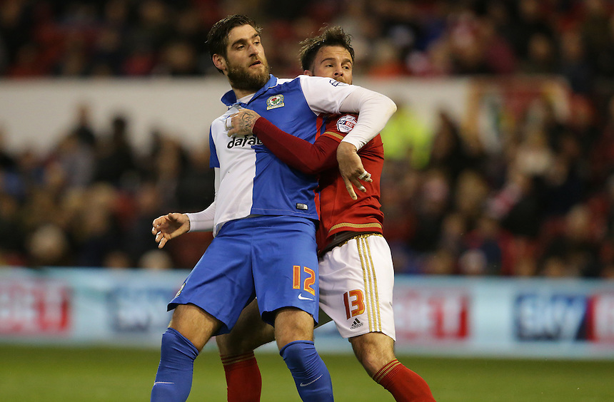 Blackburn Rovers' Danny Graham and Nottingham Forest's Danny Fox get to grips<br /> <br /> Photographer Stephen White/CameraSport<br /> <br /> Football - The Football League Sky Bet Championship - Nottingham Forest v Blackburn Rovers - Tuesday 19th April 2016 - The City Ground - Nottingham<br /> <br /> &copy; CameraSport - 43 Linden Ave. Countesthorpe. Leicester. England. LE8 5PG - Tel: +44 (0) 116 277 4147 - admin@camerasport.com - www.camerasport.com