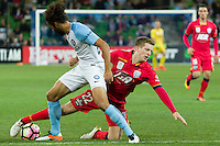 Melbourne, 28 October 2016 - RYAN KITTO (22) of Adelaide and OSAMA MALIK (6) of Melbourne City fight for the ball in the round 4 match of the A-League between Melbourne City and Adelaide United at AAMI Park, Melbourne, Australia. Melbourne won 2-1 (Photo Sydney Low / sydlow.com)