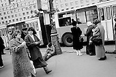 Moscow, Russia<br /> October 22, 1992<br /> <br /> Leaving the poor and pensioners with little, street drinks appear in number as well as alcohol advertisements, which are some of the first commercials to arrive in Russia. <br /> <br /> In December 1991, food shortages in central Russia had prompted food rationing in the Moscow area for the first time since World War II. Amid steady collapse, Soviet President Gorbachev and his government continued to oppose rapid market reforms like Yavlinsky's &quot;500 Days&quot; program. To break Gorbachev's opposition, Yeltsin decided to disband the USSR in accordance with the Treaty of the Union of 1922 and thereby remove Gorbachev and the Soviet government from power. The step was also enthusiastically supported by the governments of Ukraine and Belarus, which were parties of the Treaty of 1922 along with Russia.<br /> <br /> On December 21, 1991, representatives of all member republics except Georgia signed the Alma-Ata Protocol, in which they confirmed the dissolution of the Union. That same day, all former-Soviet republics agreed to join the CIS, with the exception of the three Baltic States.