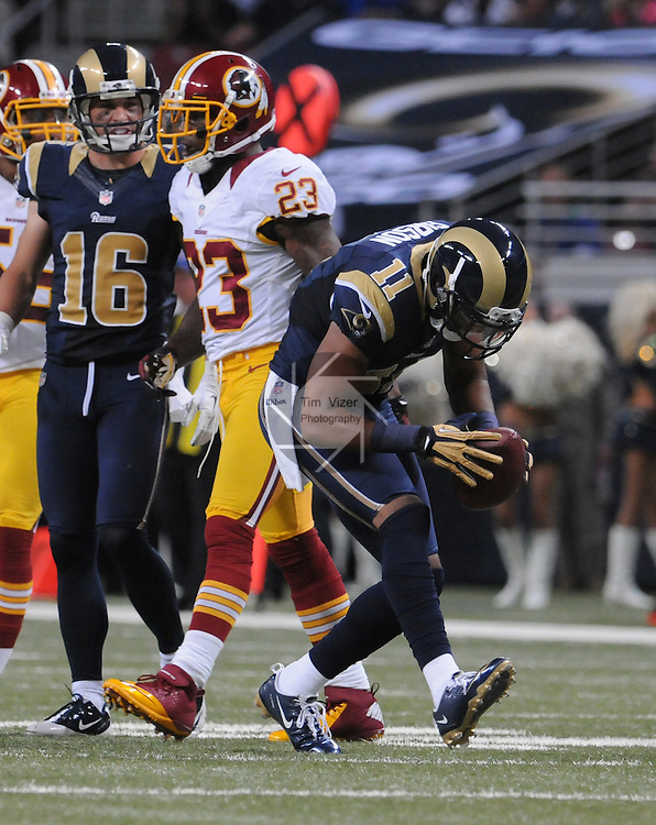 Football - NFL- Washington Redskins at St. Louis Rams.St. Louis Rams wide receiver Brandon Gibson (11) does a little dance step after he gained significant yardage in the second quarter.  Also shown is St. Louis Rams wide receiver Danny Amendola (16) and Washington Redskins cornerback DeAngelo Hall (23) in the Edward Jones Dome in St. Louis.