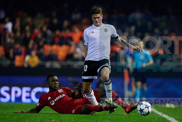 Rodrigo de Paul (R) of Valencia CF competes for the ball with Maxwell Cornet Olympique Lyonnais- UEFA Champions League Group H - Valencia CF vs Olympique Lyonnais - Mestalla Stadium - Valencia- Spain - 09th December 2015 - Pic David Aliaga/Sportimage