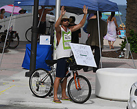 """FORT LAUDERDALE, FL - JUNE 28: A Man is seen holding a sign that reads """"I support trump don't shoot me"""" on Fort Lauderdale Beach as South Florida beaches are to close for July Fourth weekend, Florida reports another record spike in coronavirus cases, Florida's Covid-19 surge shows the state's reopening plan is not working on June 28, 2020 in Fort Lauderdale Beach, Florida. Credit: mpi04/MediaPunch"""