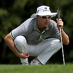Action from Round 3 of the CIMB Asia Pacific Classic 2011.  Photo © Andy Jones / PSI for Carbon Worldwide