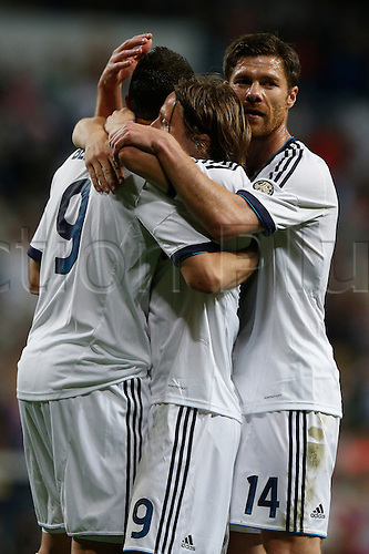 08.05.2013 Madrid, Spain. Real Madrid players celebrate Luka Modric's goal during the Spanish La Liga game between Real Madrid and Malaga from the Santiago Bernabeu...