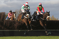 Race winner Honest John ridden by Tom Scudamore (R) and Total Rebellion ridden by Henry Brooke in jumping action during the TurfTV Novices Handicap Chase