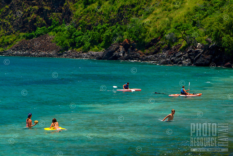 People swimming and kayaking in beautiful blue Kealakekua bay, south of Kona on the Big Island of Hawaii As of 2013 a moratorium halting all kaying in the bay has been issued by the Dept. of Land and Natural Resources. This could be revoked at anytime.