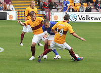 Leon Osman tackled by the combined effort of Steven Hammell and Keith Lasley in the Motherwell v Everton friendly match at Fir Park, Motherwell on 21.7.12 for Steven Hammell's Testimonial.