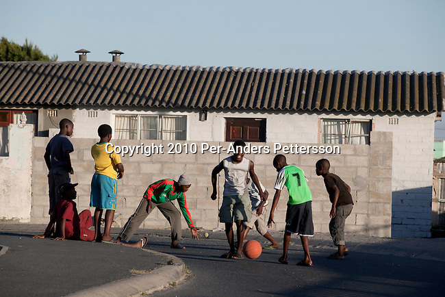 GUGULETU, SOUTH AFRICA - DECEMBER 14: Unidentified children play in the street on December 14, 2010, In Guguletu, a township outside Cape Town, South Africa. Guguletu is one of the biggest black townships in Cape Town and it was here where where British honeymooners Anni Dewani, 28, and Shrien Dewani, 31, were attacked. Anni Dewani was found with bullets in her chest in the back of the taxi after the newly weds were ambushed whilst traveling near a notorious settlement known as Barcelona. (Photo by Per-Anders Pettersson/Getty Images)