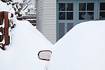 Deep snow covers a car after a winter snow storm in Missoula, Montana