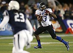 Boise State's Jeremy McNichols (13) runs against Nevada defender Nigel Haikins (23) during the first half of an NCAA college football game in Reno, Nev., on Saturday, Oct. 4, 2014. Boise State won 51-46. (AP Photo/Cathleen Allison)
