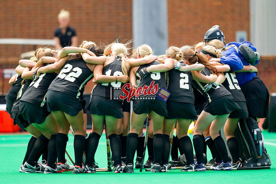 The Wake Forest Demon Deacons field hockey team huddles up prior to taking on the Iowa Hawkeyes at Kentner Stadium on August 25, 2012 in Winston-Salem, North Carolina.  The Hawkeyes defeated the Demon Deacons 3-2 in overtime.  (Brian Westerholt / Sports On Film)