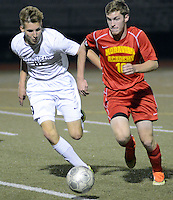 FRANCONIA, PA - NOVEMBER 11: Plumstead Christian Academy's Steven Haines #10 and Moravian Academy's Jeff Brown #10 chase a loose ball in the first half of the District One Class A semifinal soccer playoff game at Souderton High School November 11, 2014 in Franconia, Pennsylvania.  (Photo by William Thomas Cain/Cain Images)