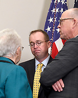Director of the Office of Management and Budget Mick Mulvaney, speaks with US Representative Virginia Foxx (Republican of North Carolina), Chair of the US House Education and Workforce Committee, left, and US Representative Greg Walden (Republican of Oregon), Chair of the US House Energy &amp; Commerce Committee, right, as they attend the ceremony where US President Donald J. Trump will sign an Executive Order to promote healthcare choice and competition in the Roosevelt Room of the White House in Washington, DC on Thursday, October 12, 2017.  The President's controversial plan is designed to make lower-premium health insurance plans more widely available.<br /> Credit: Ron Sachs / Pool via CNP /MediaPunch