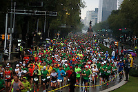 Athletes compete by Reforma Avenue Mexico City during the 32nd Mexico City International Marathon held in Mexico City, capital of Mexico, on Aug. 31, 2014. The Mexico City Marathon is a Boston Marathon qualifier. Photo by Miguel Angel Pantaleon/VIEWpress