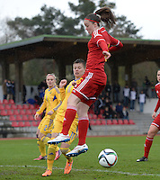 20150404 - FORST , GERMANY  : Ukrainian Tetyana Kozyrenko  (left) pictured in a duel with Belgian Tine De Caigny during the soccer match between Women Under 19 teams of Belgium and Ukraine , on the first matchday in group 5 of the UEFA Elite Round Women Under 19 at WaldseeStadion , Forst , Germany . Saturday 4th April 2015 . PHOTO DAVID CATRY