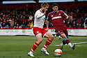 Stacy Long of Stevenage is watched by Adam McGurk of Tranmere. - Stevenage v Tranmere Rovers - npower League 1 - Lamex Stadium, Stevenage - 17th December 2011  .© Kevin Coleman 2011 ... ....  ...  . .