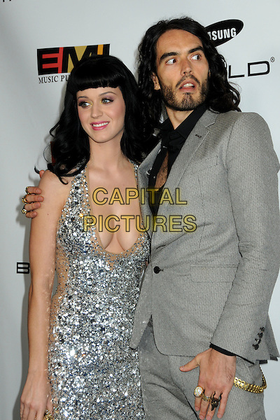 KATY PERRY & RUSSELL BRAND.EMI Post Grammy Party 2010 held at the W Hollywood Hotel, Hollywood, California, USA, 31st January 2010..half length silver sequined sequin beige cleavage beard facial hair  halterneck dress grey gray suit black shirt couple grammys  .CAP/ADM/BP.©Byron Purvis/Admedia/Capital Pictures