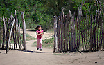 A Wichi indigenous girl in Lote 75, an indigenous neighborhood of Embarcacion, Argentina. The Wichi in this area, largely traditional hunters and gatherers, have struggled for decades to recover land that has been systematically stolen from them by cattleraisers and large agricultural plantations.