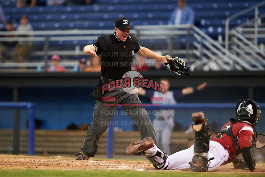 Umpire Louie Krupa calls Nick Sergakis (not shown) safe at home after a diving attempt to tag by catcher Pablo Garcia (7) during a game between the Brooklyn Cyclones and Batavia Muckdogs on July 5, 2016 at Dwyer Stadium in Batavia, New York.  Brooklyn defeated Batavia 5-1.  (Mike Janes/Four Seam Images)