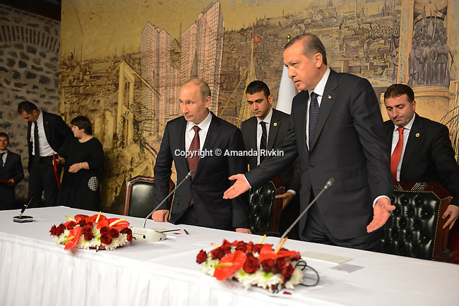 Russian President Vladimir Putin and Turkish Prime Minister Recep Tayyip Erdogan enter a joint press conference at the Turkish Prime Minister's office at Dolmabahce Palace in Istanbul, Turkey on December 3, 2012.