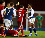 Liam Birdcutt of Scotland receives a yellow card for his bad tackle on Erik Sviatchenko of Denmark during the Vauxhall International Challenge Match match at Hampden Park Stadium. Photo credit should read: Simon Bellis/Sportimage