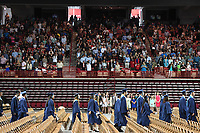 NWA Democrat-Gazette/J.T. WAMPLER Graduates file into place Saturday May 20, 2017 during commencement ceremonies for Springdale Har-Ber High School held at Bud Walton Arena on the University of Arkansas campus in Fayetteville. This is the 12th commencement for the school and 651 seniors graduated.