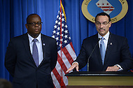 Washington, DC - September 25, 2014: D.C. Mayor Vincent C. Gray (r) announces Daniel Lucas (l) as his nominee for D.C. Inspector General. Lucas has served as Deputy Inspector General for Naval Sea systems Command.  (Photo by Don Baxter/Media Images International)