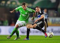 FUSSBALL   1. BUNDESLIGA   SAISON 2011/2012   27. SPIELTAG VfL Wolfsburg - Hamburger SV         23.03.2012 Marco Russ (li, VfL Wolfsburg) gegen Marcus Berg (re, Hamburger SV)