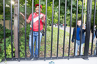 MOSCOW, RUSSIA - June 14, 2018: A Peru fan talks with friends after jumping the fence outside Moscow State University attempting to enter the Moscow FIFA Fan Fest during the opening match of the 2018 FIFA World Cup. The Fan Fest was closed by officials because it was at capacity.