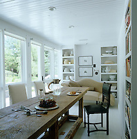 In the breakfast room what looks like an antique refectory table is actually a contemporary design by Darryl Carter