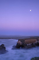 California, Point Arena, Rock arch at mouth of Garcia River with full moon