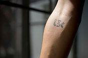 Former University Apartments resident Jess Schell loved her apartment enough to have the address tattooed on her forearm.
