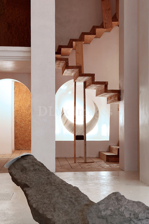 wooden staircase and sculptures