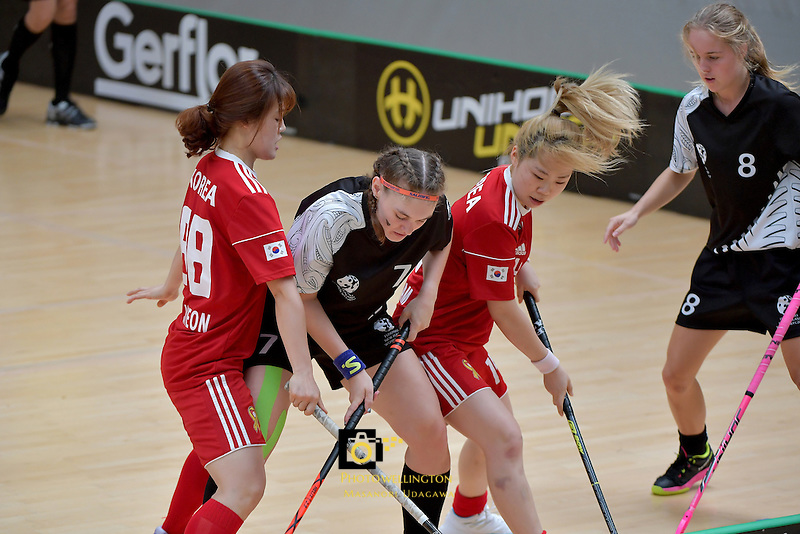 New Zealand's Sophie Scott and Korea's Boram Yoon in action during the World Floorball Championships 2017 Qualification for Asia Oceania Region - New Zealand v Korea at ASB Sports Centre , Wellington, New Zealand on Sunday 5 February 2017.<br /> Photo by Masanori Udagawa<br /> www.photowellington.photoshelter.com.