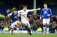Gareth Barry competes with Gylfi Sigurdsson during the Barclays Premier League match between Everton and Swansea City played at Goodison Park, Liverpool