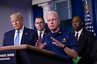 Admiral Brett Giroir, United States Assistant Secretary for Health makes remarks on the Coronavirus crisis in the Brady Press Briefing Room of the White House in Washington, DC on Saturday, March 21, 2020.  From left to right: US President Donald J. Trump; Pete Gaynor, Administrator, Federal Emergency Management Agency (FEMA); Adm. Giroir; and US Secretary of Housing and Urban Development (HUD) Ben Carson.<br /> Credit: Stefani Reynolds / Pool via CNP/AdMedia