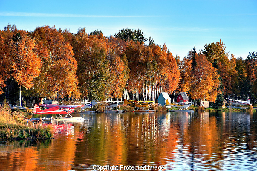 Fall colors provide a spectacular backdrop in Alaska's Lake Hood.