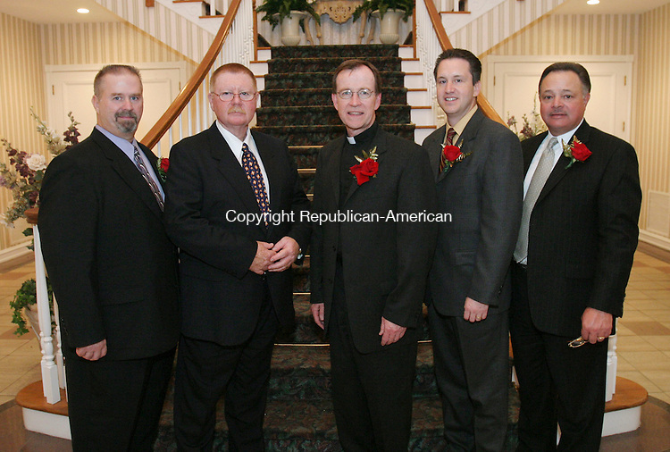 SOUTHINGTON, CT 01 November 2005 -110105BZ06- From left-  Don Donahue, of Waterbury; Ron Dubuque, of Waterbury; Father Joe Donnelly, of Southbury; Rob Kane, of Watertown; Richard Scappini, of Waterbury<br /> <br /> during the Sacred heart High School Annual Awards Dinner and Silent Auction at the Aqua Turf in Southington Tuesday night.<br /> Jamison C. Bazinet Republican-American