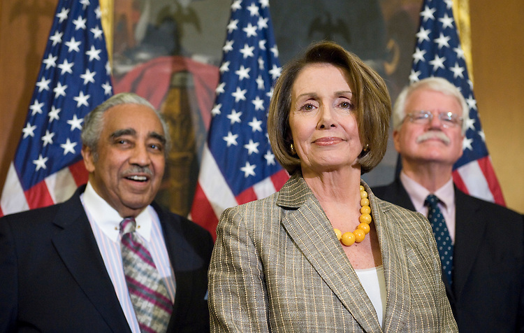 From left, House Ways and Means Committee chairman Charlie Rangel, D-N.Y., Speaker of the House Nancy Pelosi, D-Calif., and House Education and Labor Committee chairman George Miller, D-Calif., participate in a news conference on the House's healthcare reform bill on Friday, July 17, 2009.
