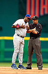 15 May 2005: Dusty Baker, Manager of the Chicago Cubs, argues a play at second with Umpire Dale Scott during a game against the Washington Nationals, as the Nationals defeat the visiting Cubs 5-4, to take the 3-game series three games to two, at RFK Stadium in Washington, DC.  Mandatory Photo Credit: Ed Wolfstein