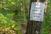 Warning sign along the Holt Trail which climbs to the summit of Cardigan Mountain in Orange , New Hampshire USA. A section of this trail is considered extremely steep and rough.