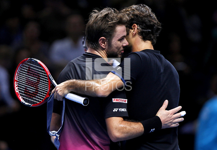 Roger Federer and Stan wawrinka of Switzerland hug at the net at the ATP World Tour Finals, The O2, London, 2015