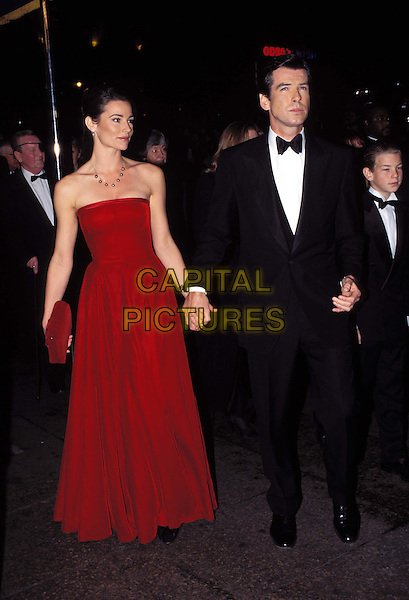 PIERCE BROSNAN  & KEELEY SHAYE SMITH.Ref: 1766 .second wife, full length, full-length, long red dress, strapless, holding hands.*RAW SCAN - photo will be adjusted for publication*.www.capitalpictures.com.sales@capitalpictures.com.© Capital Pictures