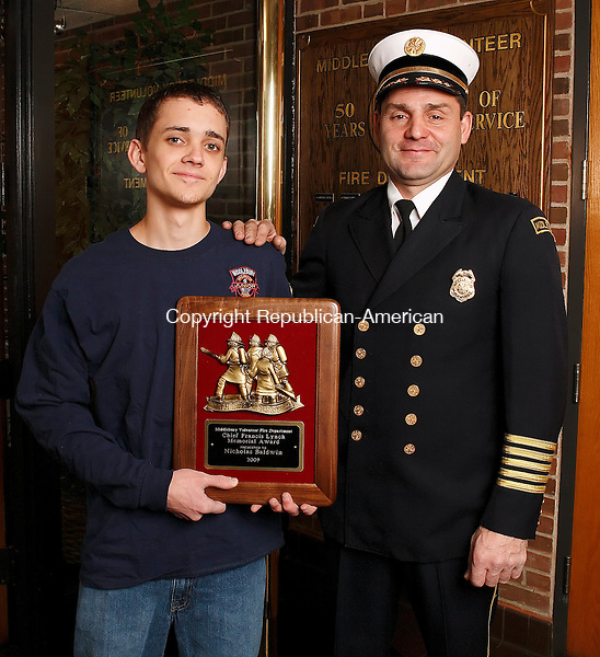 "Middlebury, CT-31, December 2009-123109CM04 -- Middlebury Fire Department's Chief Paul Perrotti (right) stands with Nick Baldwin, 18, of Middlebury . Baldwin was recently awarded the Chief Francis Lynch Memorial Award, aka ""good kid award.""  Baldwin, a 4th generation firefighter.  The award is presented to a young standout member of the department each year.  Christopher Massa Republican-American"
