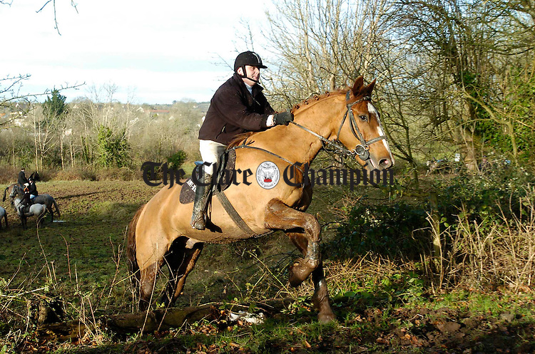 Up and Over....Horse and rider combine forces to negotiate a stone wall during the East Clare Harriers Hunt at Clonlara. Photograph by John Kelly.