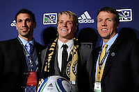 Philadelphia Union draft pick Brian Perk with goalkeeper coach Rob Vartughian (L) and assistant coach John Hackworth (R) during the MLS SuperDraft at the Pennsylvania Convention Center in Philadelphia, PA, on January 14, 2010.