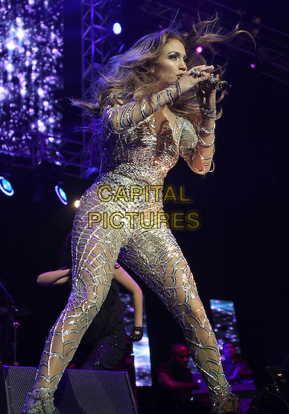 JENNIFER LOPEZ.The KIIS FM Wango Tango 2011 held at The Staples Center in Los Angeles, California, USA,.May 14th 2011..stage performing music concert gig live JLo J.Lo music full length microphone silver cut out long sleeve gold flesh nude suit catsuit bodysuit singing glittery ankle boots lace-up .CAP/ADM/KB.©Kevan Brooks/AdMedia/Capital Pictures.