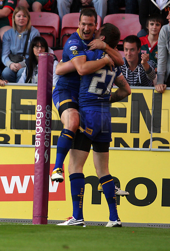 01.07.2011 Engage Super League Rugby from the DW Stadium. Wigan Warriors v Leeds Rhinos. Former Featherstone player Zak Hardaker dives across the line to score a try and then celebrates with his team mates.